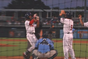 Niko Goodrum crosses the plate after a two-run homerun.