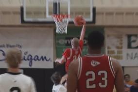 Maverick Rowan dunks for two in Cardinal Gibbons' win over Mariner.