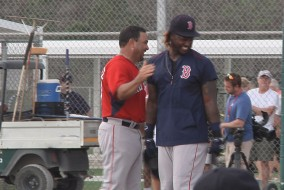 Red Sox Assistant Hitting Coach shares a laugh with Hanley Ramirez.